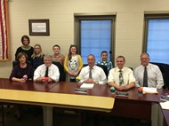 Photo of students with Board of Education