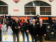 Piqua VFW donating the flag to Supt. Stephens at a recent basketball game