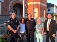 Photo of village staff and Arcanum-Butler staff with new SRO